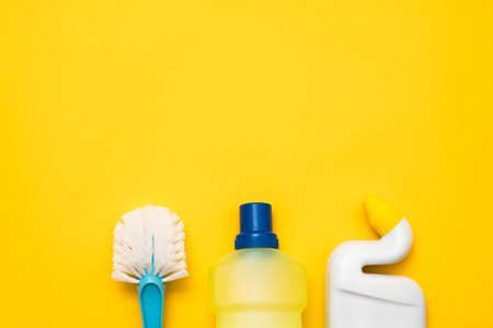 Toilet cleaning kit. DIY cleanup. Sanitary supplies beneath copy space on yellow background. Stock Photo