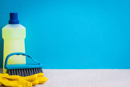 Flooring cleaning supplies. Basic clean up set. Copy space on blue background.
