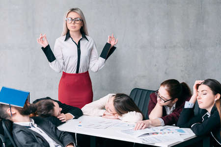 Annual accounting overworking. Tired business team sleeping at workplace. Shocked boss standing with mudra hands. Stockfoto