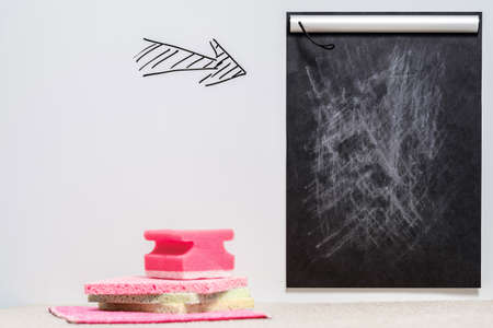 Home cleaning to do list. Mockup on white background with pointing arrow. Stock Photo