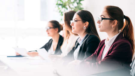 Job opening. Employee selection. Corporate representatives listening to virtual vacancy applicant. Stock Photo