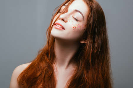 Peace of mind. Freedom of youth. Young redhead female. Eyes closed. Naked shoulders. Stok Fotoğraf