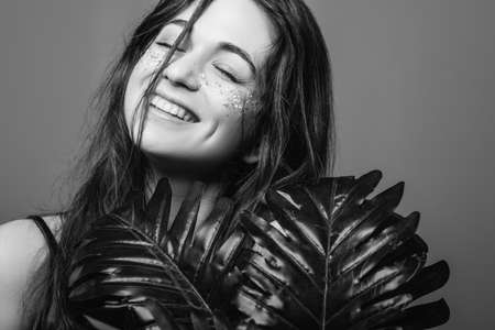 Woman beauty. Youth optimism and happiness. Smiling female posing with eyes closed. Black and white. Stock Photo