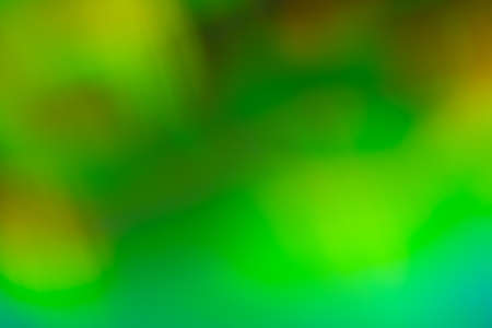 Green soft blurry defocused background. Lens flare light effect. Illuminated abstract glow . Stock Photo