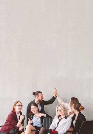 High five and thumb up. Bussines team celebrating success. Teamwork collaboration and achievements. Happy smiling coworkers. Copy space above
