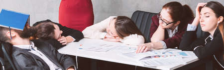 Annual report overworking. Business pressure and fatigue. Tired exhausted team sleeping at workplace. 写真素材