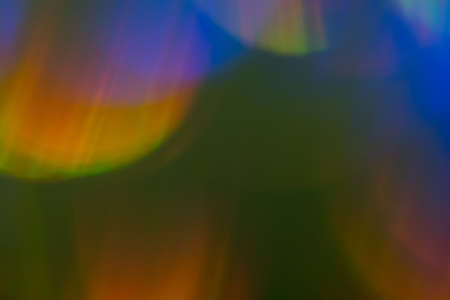 Blurred colorful lights. Abstract lens flare effect background. Bokeh illuminated glow.