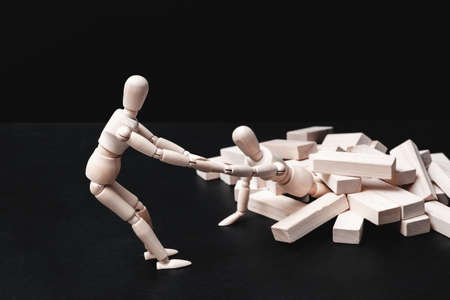 Helping hand. Support and problem solution. Teamwork and cooperation. Conceptual articulated mannequin composition.