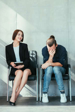 Business competition. Young lady gloating over guy failed job interview. Nonprofessional corporate relationship.