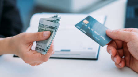 Man drawing on his credit account. Bank financial service. Paying off loan with plastic card. Income not covering expenses. Stock Photo