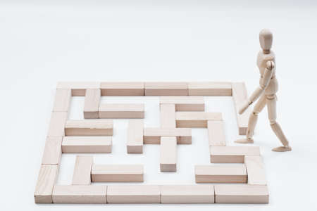 Challenge and obstacle. Strategy and solution. Creative idea and decision. Unlock potential. Wooden man and block maze.