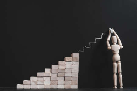 Ambition and aspiration. Future success. Wooden mannequin chalking steps to complete stairs. Career growth dream.