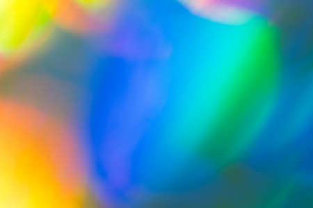 Blurred colorful abstract background with bright speck of light. Defocused blue and yellow spots. Lens flare effect. Stock Photo