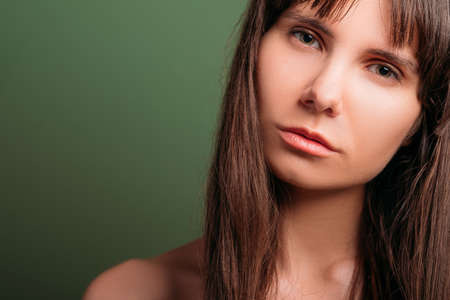 Confused looking beautiful girl. Disappointed facial expression. Closeup portrait of emotional lady. Copy space. Stock Photo
