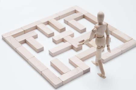Encourage creativity. Think different. Dream big. Challenge. Blocks maze. Conceptual articulated mannequin composition