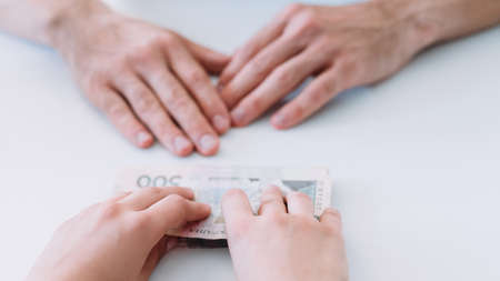 Financial support. Woman offers man money loan in cash. Business sponsorship and patronage.
