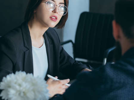 Human resources manager interviewing applicant for job opening. Recruitment and employment. Business meeting. Stock Photo