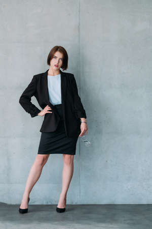 Confident young business lady. Successful corporate life. Formal dress code.