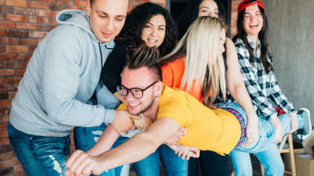 Millennials active lifestyle and leisure. Socializing and teambuilding. Young people having fun together after successful work. Stock Photo
