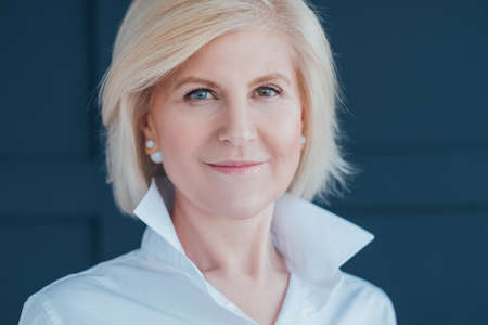 Confident aged business woman. Modern lifestyle. Seniority independence and personal development. Heterochromia.