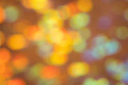 Abstract background. Defocused multicolor blurred circles. Illuminated glowing bokeh lights.