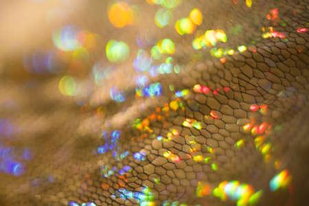 Golden glittering texture. Defocused bokeh light. Lens flare effect.