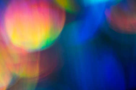 Blur colorful lens flare spots. Defocused abstract background. Bokeh Illuminated glow.