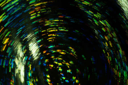 Bokeh lens flare lights. Whirling multicolor lines on dark background. Blured swirly design. Фото со стока