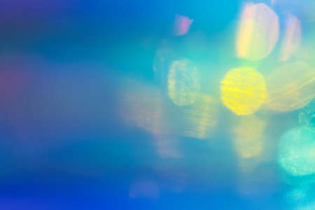 Blurred blue and green abstract lens flare background. Defocused glow effect. Illuminated bokeh 写真素材