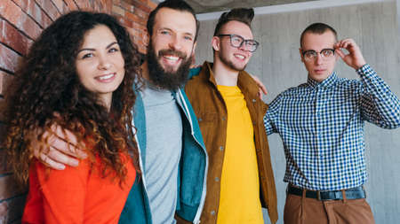 Equality, diversity and inclusion. Friendly and tolerant millennials. Hipsters getting on well with geek guy. Successful teamwork. Stock Photo