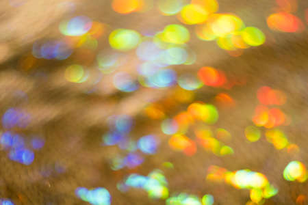 Blurry colorful circles. Defocused lens flare bokeh lights. Festive abstract background decoration.