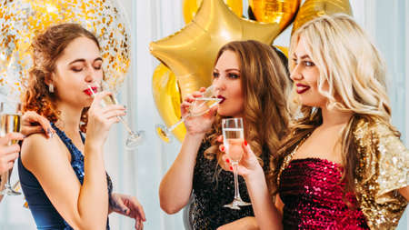 Hen party. Female friendship. Girls looking jealous of their bestie. Fake happiness for lucky woman. Stock Photo