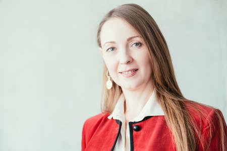 Professional success. Closeup portrait of prosperous business woman in red blazer. Confident facial expression. Imagens