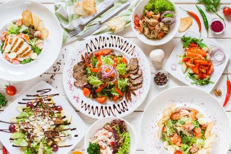 Top view of food meals selection. Restaurant banquet dinner. Buffet menu.