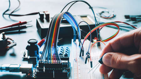 Microcontroller innovation. Hardware engineering hobby. Electronic breadboard components. Programmer smart home hobby. Stock Photo