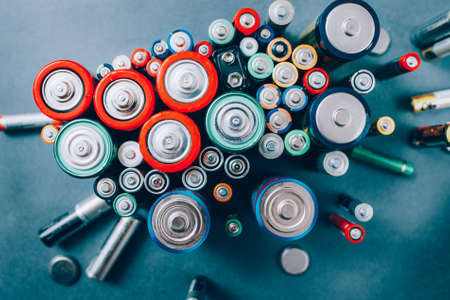 Battery recycling. Environmental protection. Ecology concept. Top view of colorful accumulators. Creative energy composition.