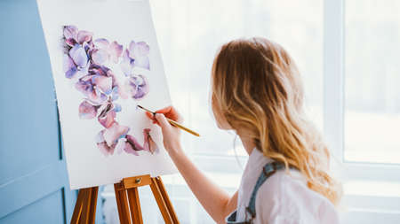 Artist lifestyle. Painting hobby. Imagination and inspiration. Talented woman creating beautiful watercolor floral design.