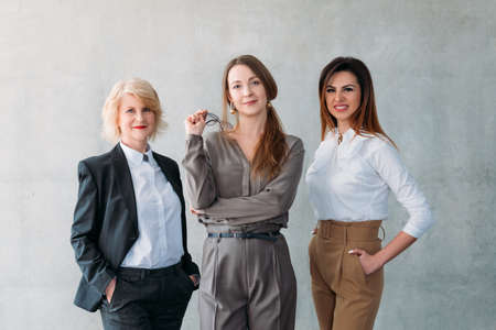 Successful business women. Cooperation and partnership. Mature and young ladies holding leader positions. 写真素材 - 121261038