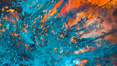 Abstract art texture background. Red sunset sky design. Beautiful blue and orange paint mixture splash.