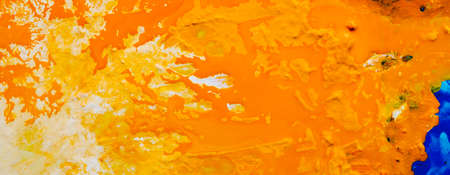 Abstract white yellow orange color background. Acrylic paint liquid fluid mix blend texture pattern. Art effect technique.