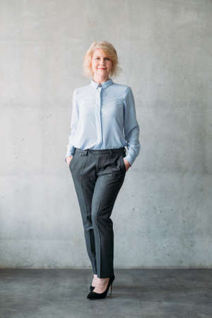 Senior lady full length. Hands in pockets. Confident business female. Classy smart successful corporate company, ceo boss.