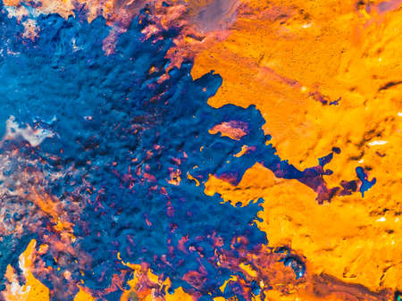 Abstract art texture background. Seaside aerial view design. Orange and blue paint mixture splash with flowing effect.