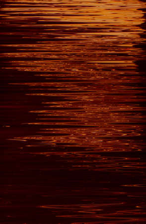 Abstract art texture background. Moon light reflection on water surface design. Red shades paint with ripple effect. Stockfoto