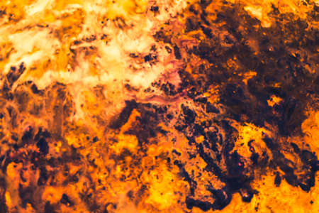 Abstract art texture background. Closeup of bonfire design. Orange and brown paint splash with marbled effect.