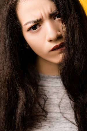 Closeup portrait of doubtful emotional brunette girl tilting head. Beautiful lady with disturbed, uncertain facial expression. Stock Photo - 122885476