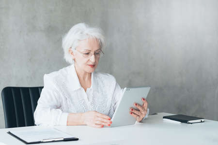 Confident business lady with tablet. Digital analysis. Company performance. Competent financial management. Great sales. Stock Photo