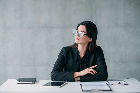 Female leader. Successful professional career. Confident business woman in eyeglasses with thoughtful facial expression.