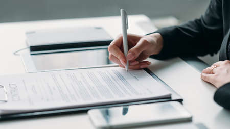 Modern business investment. Corporate relationship. Closeup of female hand signing contract. Stock fotó