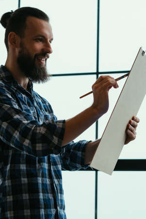Artist delight. Smiling bearded guy with board panel. Painting gaining inspiration generating ideas mastering skills. Hobby.