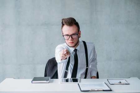 Human resources. Angry hr manager firing employee, showing the door. Furious facial expression. Stockfoto